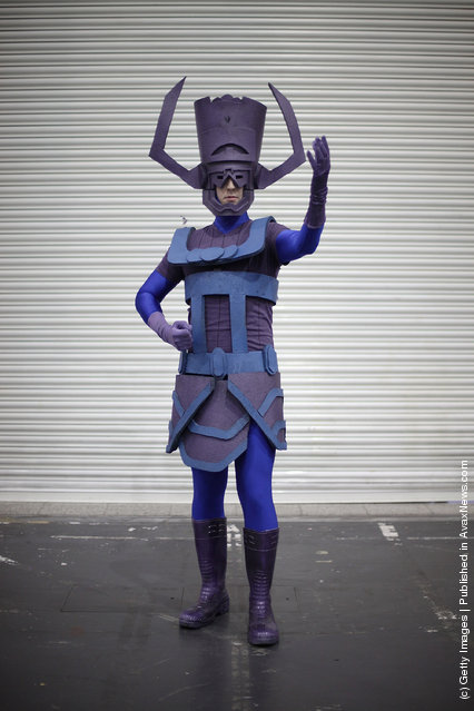 A visitor to the London Super Comic Convention wears a Galactus costume at ExCel