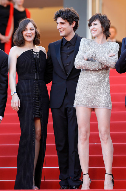 """(L-R) Marion Cotillard, Louis Garrel and Charlotte Gainsbourg attend the """"Ismael's Ghosts (Les Fantomes d'Ismael)"""" screening and Opening Gala during the 70th annual Cannes Film Festival at Palais des Festivals on May 17, 2017 in Cannes, France. (Photo by Andreas Rentz/Getty Images)"""