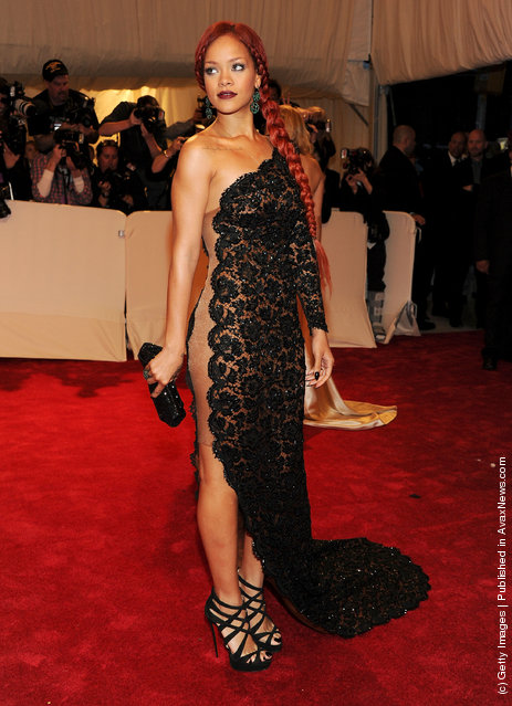 Singer Rihanna attends the 'Alexander McQueen: Savage Beauty' Costume Institute Gala at The Metropolitan Museum of Art
