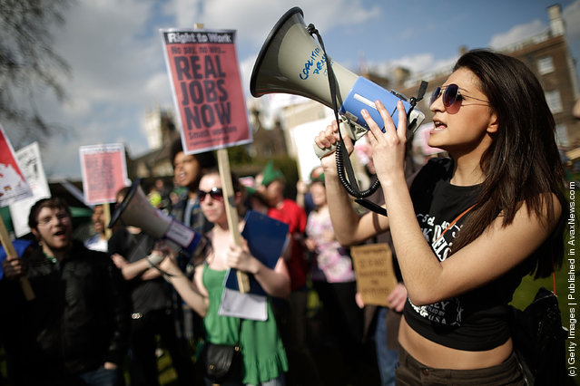 Demonstrators gather on College Green opposite the Houses of Parliament to protest against the Government's austerity measures as the Chancellor of the Exchequer George Osborne presents his annual budget to Parliament in London