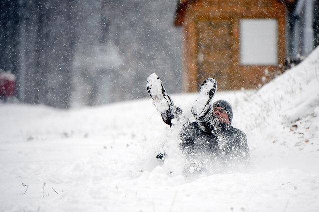 A man enjoys the fresh snow on Kekesteto mountain, northern Hungary, 02 December 2019. (Photo by Péter Komka/EPA/EFE)