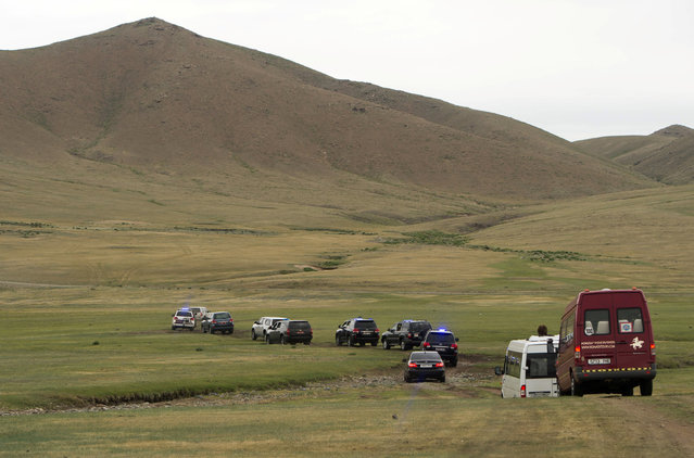 US Secretary of State John Kerry's motorcade drives off-road as he arrives to attend a Naadam ceremony, a competition which traditionally includes horse racing, Mongolian wrestling and archery, in Ulan Bator, Mongolia, June 5, 2016. (Photo by Saul Loeb/Reuters)