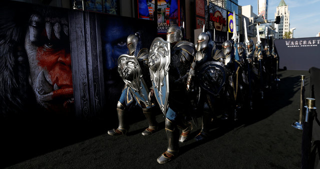 """People dressed like knights walk the carpet at the premiere of the movie """"Warcraft"""" in Hollywood, California U.S., June 6, 2016. (Photo by Mario Anzuoni/Reuters)"""