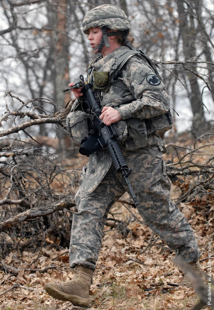 Staff Sgt. Stephanie M. Piekarczyk with the Non- Commissioned Officer Academy at Fort Dix, N.J., follows her compass to her next point for the daytime land navigation event of the 2011 Regional Army Reserve Best Warrior Competition here May 3