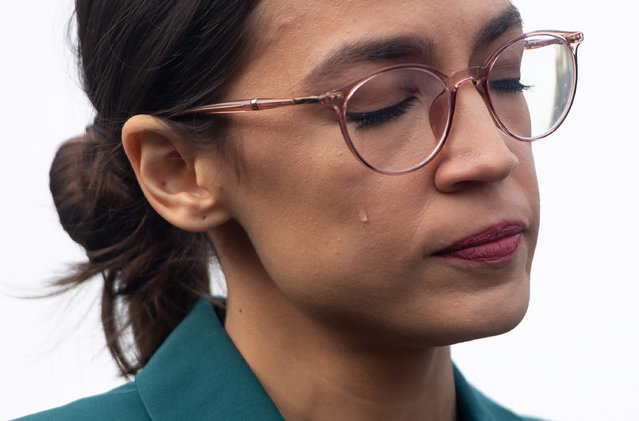 US Representative Alexandria Ocasio-Cortez, Democrat of New York, sheds a tear during a press conference calling on Congress to cut funding for US Immigration and Customs Enforcement (ICE) and to defund border detention facilities, outside the US Capitol in Washington, DC, February 7, 2019. (Photo by Saul Loeb/AFP Photo)