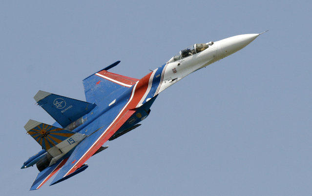 In this Saturday, May 26, 2007 file photo, a Sukhoi Su-27 fighter jet of the Russian air force elite aerobatic team Russkiye Vityazi (Russian Knights) makes a low pass during an air show in Rostov-on-Don, Russia. A pilot of the Russian air force's elite aerobatic squadron died Thursday, June 9, 2016 when his fighter jet crashed near Moscow. The Russian Defense Ministry said the Su-27 fighter jet went down while returning from a training mission. It said, according to preliminary information, the crash had been caused by a technical malfunction, but wouldn't elaborate pending an official probe. (Photo by Sergei Venyavsky/AP Photo)