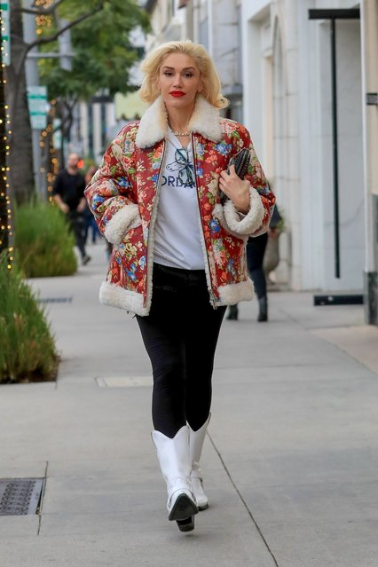 Gwen Stefani looks gorgeous Christmas shopping in Beverly Hills, CA. on December 23, 2019. The singer dons white leather cowboy boots with black pants and a floral print coat. (Photo by Backgrid USA)