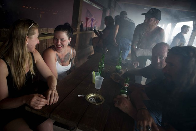 Revellers  participate in the annual Sturgis Motorcycle Rally at The Knuckle Saloon in Sturgis, South Dakota, August 4, 2015. (Photo by Kristina Barker/Reuters)