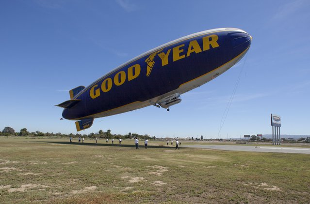 """The Goodyear blimp """"Spirit of America"""" takes off from Carson, California August 5, 2015. (Photo by Mike Blake/Reuters)"""