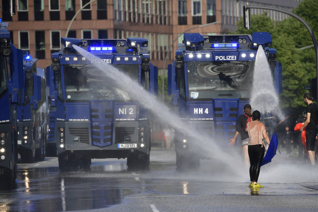 Police use water cannons as protesters gather to participate in an anti-G20 march on July 7, 2017 in Hamburg, Germany. Authorities are braced for large-scale and disruptive protests as Leaders of the G20 group of nations arrive in Hamburg for the July 7-8 G20 summit. (Photo by Alexander Koerner/Getty Images)