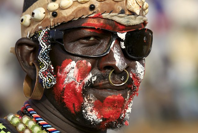 A wrestler from the Nuba Mountains tribe is seen during a celebration of their cultural heritage, as part of ongoing events to commemorate the International Day of the World's Indigenous Peoples, in Omdurman August 15, 2015. (Photo by Mohamed Nureldin Abdallah/Reuters)