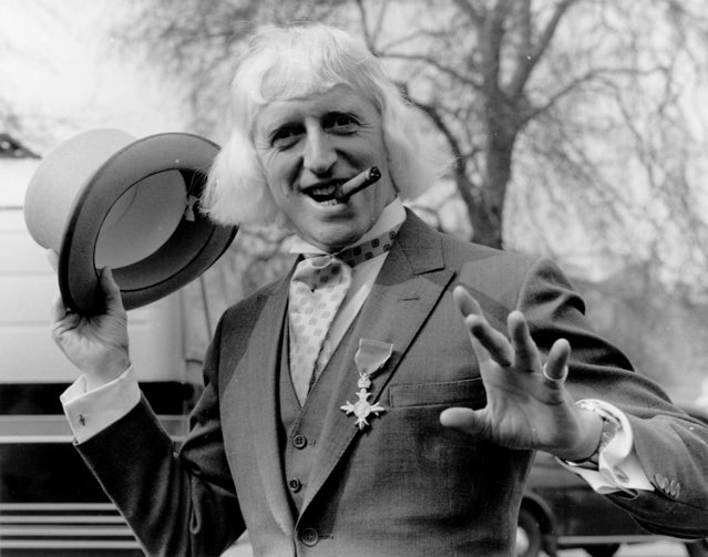 British radio disc jockey, television broadcaster and charity fundraiser Sir Jimmy Savile sporting his OBE after his investiture at Buckingham Palace, London, 1972. (Photo by Fox Photos/Getty Images)