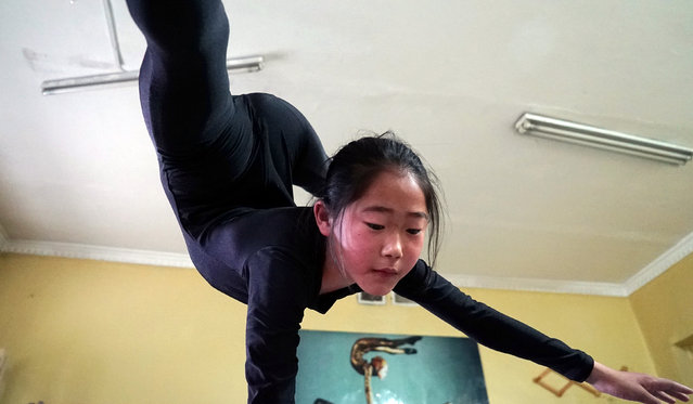 A young contortionist practices at a training school in Ulaanbaatar, Mongolia, July 4, 2016. (Photo by Natalie Thomas/Reuters)
