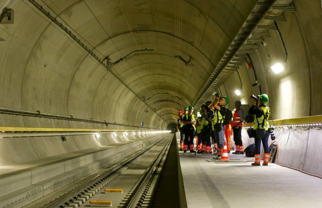 Journalists stand at a multifunction and emergency stop station of the NEAT Gotthard Base Tunnel during a media visit near the town of Sedrun August 24, 2015. (Photo by Arnd Wiegmann/Reuters)