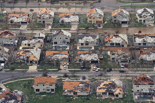 This August 25, 1992 file photo shows rows of damaged houses between Homestead and Florida City, Fla. Two decades after Andrew devastated the area, Homestead and Florida City have doubled in size into a demographically different community, better prepared to deal with hurricanes. (Photo by Mark Foley/AP Photo)