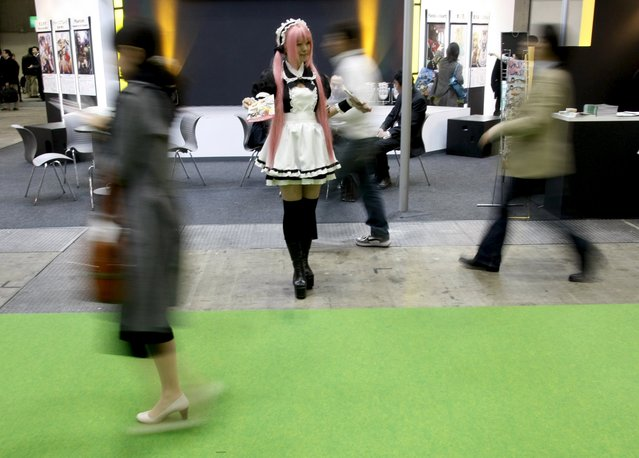 A model dressed in an animation character's costume distributes leaflets to visitors at Tokyo International Anime Fair 2009 in Tokyo in this March 18, 2009 file photo. (Photo by Kim Kyung-Hoon/Reuters)
