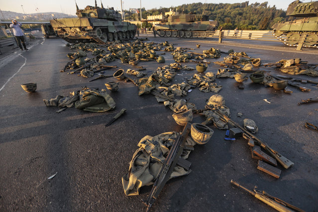Clothes and weapons beloging to soldiers involved in the coup attempt that have now surrendered lie on the ground abandoned onBosphorus bridge on July 16, 2016, Istanbul,Turkey. (Photo by Gokhan Tan/Getty Images)