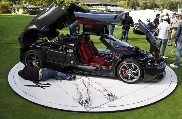Technicians put the finishing touches on a Pagani Huayra supercar during The Quail, A Motorsports Gathering car show in Carmel, California, August 15, 2014. (Photo by Michael Fiala/Reuters)