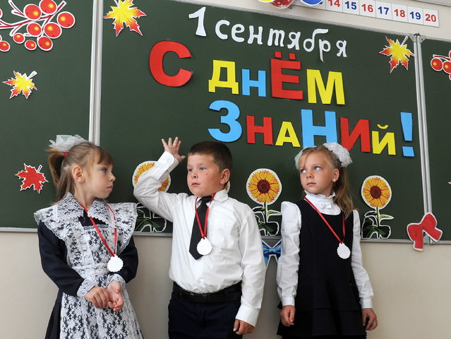 Schoolchildren attend their first lesson on Knowledge Day in the town of Turov, Zhytkavichy District, Gomel Region, Belarus on September 1, 2017. Knowledge Day marks the beginning of a new school year in Belarus and is celebrated on September 1. (Photo by Viktor Drachev/TASS via Getty Images)