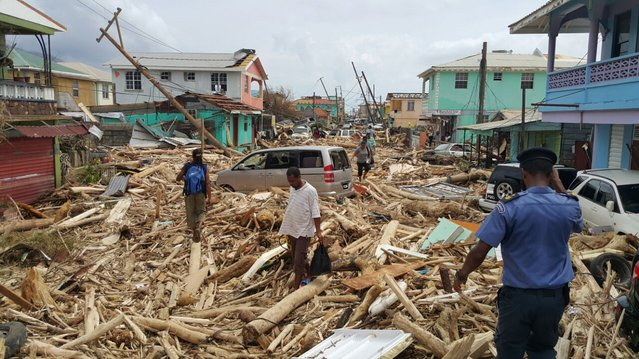 View of damage caused the day before by Hurricane Maria in Roseau, Dominica, on September 20, 2017. Hurricane Maria smashed into the eastern Caribbean island of Dominica on Tuesday, with its prime minister describing devastating damage as winds and rain from the storm also hit territories still reeling from Irma. (Photo by AFP Photo/Stringer)