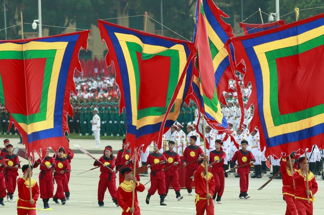 Performers carry traditional flags during a parade marking their 70th National Day at Ba Dinh square in Hanoi, Vietnam September 2, 2015. (Photo by Reuters/Kham)