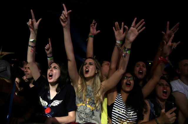 Rock fans cheer during the Rock in Rio Music Festival in Rio de Janeiro, Brazil, September 23, 2017. (Photo by Pilar Olivares/Reuters)