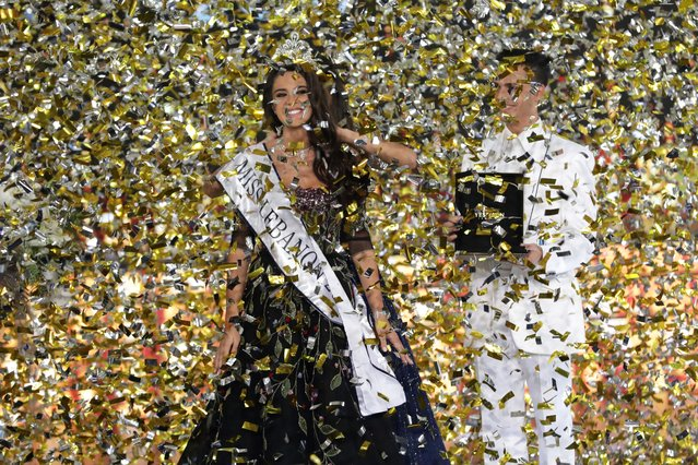 Newly crowned Miss Lebanon 2017 Perla Helou (L) reacts after being elected at Casino Du Liban in Jounieh, north of Beirut, on September 24, 2017. (Photo by Anwar Amro/AFP Photo)
