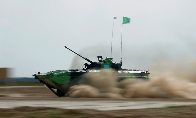 A BMP-2 amphibious infantry fighting vehicle, operated by a crew from Kazakhstan, drives during a competition of the International Army Games 2016, at a range in the settlement of Alabino outside Moscow, Russia, August 2, 2016. (Photo by Maxim Shemetov/Reuters)