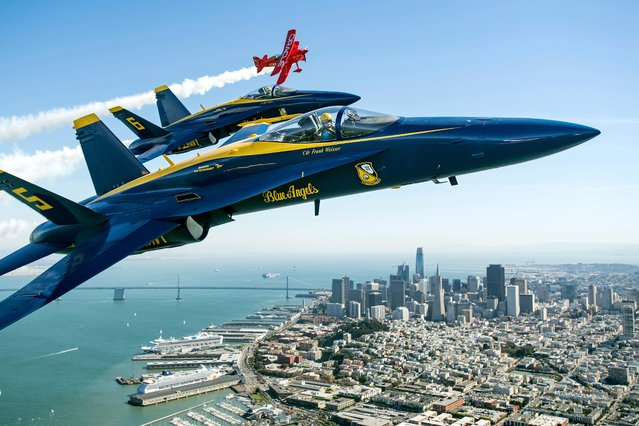 In advance of Fleet Week performances, the U.S. Navy Blue Angels and Team Oracle aerobatics pilot Sean D. Tucker fly over the San Francisco Bay during a photo flight on Thursday, October 5, 2017. (Photo by Noah Berger/AP Photo)