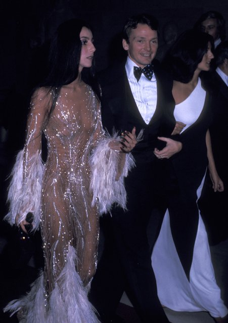 Cher and Bob Mackie attends The Metropolitan Museum of Art's Costume Insitute Gala Exhibition 'Romantic and Glamorous Hollywood Design' on November 28, 1974 at The Metropolitan Museum of Art in New York City. (Photo by Ron Galella, Ltd./Ron Galella Collection via Getty Images)