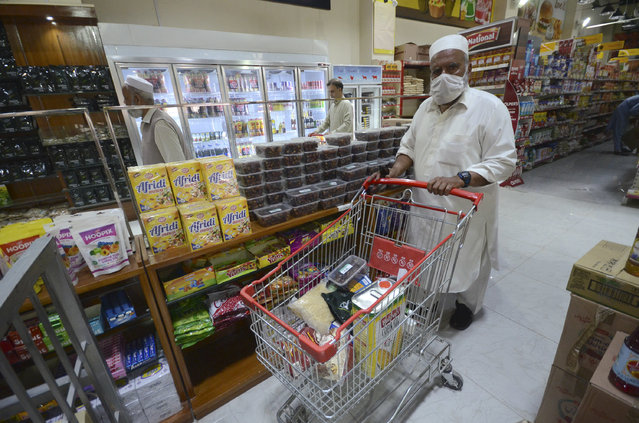 Residents buy food items at a store ahead of Ramadan in Peshawar, Khyber Pakhtunkhwa, Pakistan on April 22, 2020, during a government-imposed nationwide lockdown as a preventive measure against the (COVID-19) corona virus. (Photo by Hussain Ali/Pacific Press/LightRocket via Getty Images)