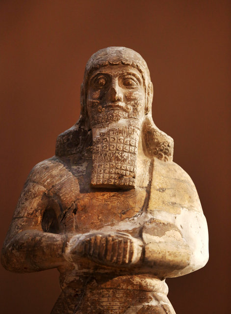 This Monday, September 15, 2014 photo shows, a stone statue displayed at the Iraqi National Museum in Baghdad. The Islamic State militants seek to purge society of all influences that don't conform with their strict, puritanical version of Islam. That means destroying not only relics seen as pagan but also Muslim sites they see as contradicting their ideology, particularly Sunni Muslim shrines they see as idolatrous as well as mosques used by Shiites, a branch of Islam they consider heretical. (Photo by Hadi Mizban/AP Photo)