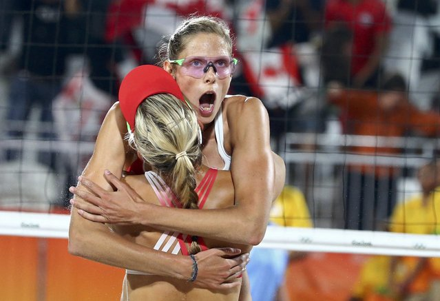 2016 Rio Olympics, Beach Volleyball, Women's Preliminary, Beach Volleyball Arena, Rio de Janeiro, Brazil on August 10, 2016. Sarah Pavan (CAN) of Canada embraces Heather Bansley (CAN) of Canada during their match against Switzerland. (Photo by Ruben Sprich/Reuters)