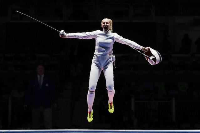 Russia's Violetta Kolobova celebrates after defeating Estonia during the bronze medal bout of the women's epee team fencing competition in the 2016 Summer Olympics in Rio de Janeiro, Brazil, Thursday, August 11, 2016. (Photo by Gregory Bull/AP Photo)