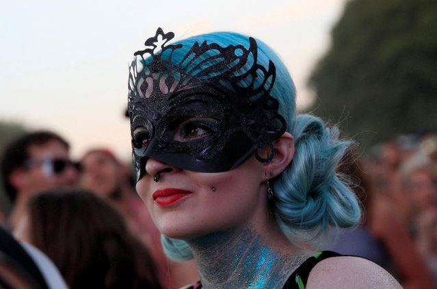 A festivalgoer attends a concert by the British singer Tinie Tempah during Sziget music festival on an island in the Danube River in Budapest, Hungary, August 14, 2016. (Photo by Bernadett Szabo/Reuters)