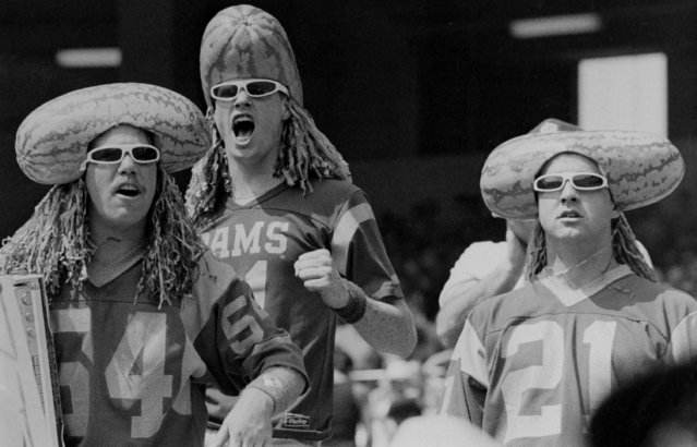 The coneheads are given a run for the money by these three Ram fans, wearing watermelons on their heads, at the Rams-Minnesota Vikings game at Anaheim Stadium, September 21, 1987. Whether their appearance was meant as hex or boost, the Rams lost, 21-16. (Photo by Reed Saxo/AP Photon)