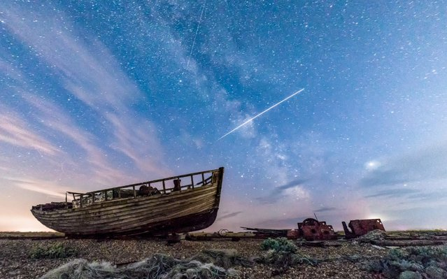 Photographer Wayne Howes captured the incredible moment the International Space Station crossed over the Milky Way. Captured in Dungeness, Kent. (Photo by Wayne Howes/Cover Images)