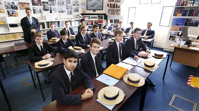 Students in Dr. Hugh McCormick's lower sixth politics division (year 12) sit in their classroom in Old Schools on the last day of term at Harrow School in Middlesex, Britain, June 16, 2015. Noteable Old Harrovians include Winston Churchill, King Hussein of Jordan, Lord Byron and Benedict Cumberbatch. (Photo by Suzanne Plunkett/Reuters)