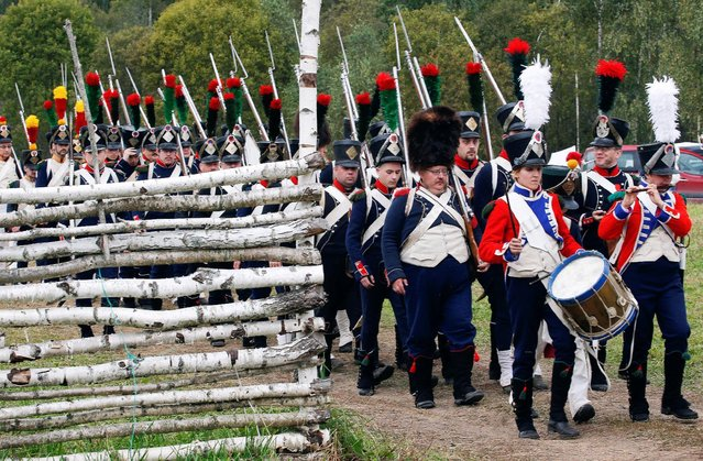 Participants reenact the 1812 Battle of Borodino between Russia and the invading French army during anniversary celebrations in Moscow region, Russia, September 4, 2016. (Photo by Sergei Karpukhin/Reuters)