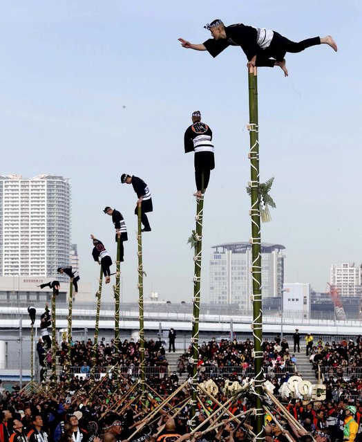Members of a traditional firefighting preservation group perform on top of bamboo ladders during the annual New Year's Fire Brigade Review in Tokyo, January 6, 2013. (Photo by Shizuo Kambayashi/Associated Press)