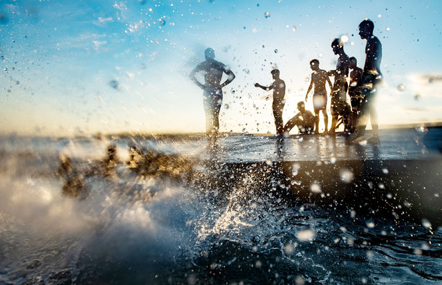 People cool off at the Menekse beach during the last day of the celebrations of the Eid-al-Adha holiday amid the ongoing pandemic of coronavirus at the sunset in Istanbul, Turkey, on August 3, 2020. (Photo by Yasin Akgul/AFP Photo)
