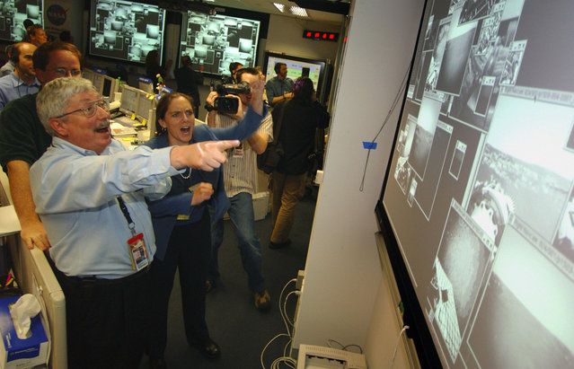 On the day of Opportunity's landing – 202 days after launch – Pete Theisinger, Project Manager, and Jennifer Trosper, Spirit Mission Manager for Surface Operations react as the first images arrive from the NASA Mars Rover Opportunity. (Photo by Bill Ingalls/AFP Photo/The Atlantic)