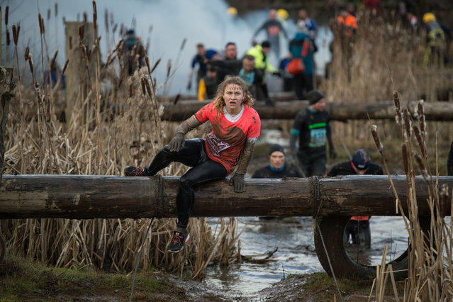 Competitors participate in the Tough Guy endurance event near Wolverhampton, central England, on February 4, 2018. The Tough Guy event challenges thousands of competitors to run a gruelling course whilst negotiating over 200 obstacles including water, fire, and tunnels. (Photo by Oli Scarff/AFP Photo)