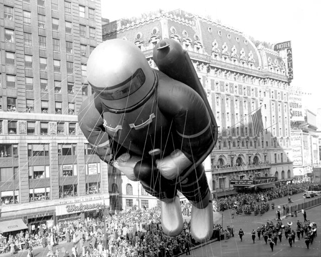 Helium-filled rubber space man, 70 feet tall, indicative of the latest adventure interest of America's kids, bobs along in 27th annual Macy's Thanksgiving Day parade, 1953. (Photo by Nick Sorrentino/NY Daily News Archive via Getty Images)