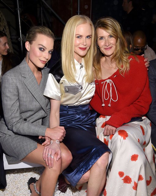Actors Margot Robbie, Nicole Kidman, and Laura Dern attend the Calvin Klein Collection front row during New York Fashion Week at New York Stock Exchange on February 13, 2018 in New York City. (Photo by Dimitrios Kambouris/Getty Images)