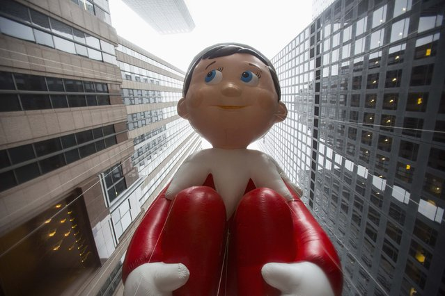 The Elf on the Shelf balloon floats down Sixth Avenue during the 88th Annual Macy's Thanksgiving Day Parade in New York November 27, 2014. (Photo by Andrew Kelly/Reuters)