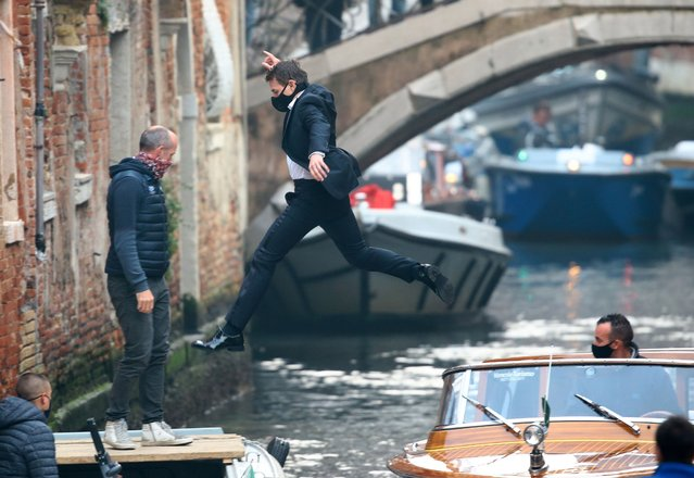 "American actor Tom Cruise was seen jumping from a water taxi on the set of ""Mission: Impossible 7"" on October 20, 2020 in Venice, Italy. (Photo by Splash News and Pictures)"