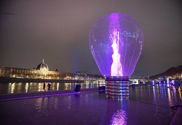 View of a giant incandescent light bulb as part of the Incandescence installation by artist Severine Fontaine during the rehearsal for the Festival of Lights in central Lyon late in the night December 4, 2014. (Photo by Robert Pratta/Reuters)