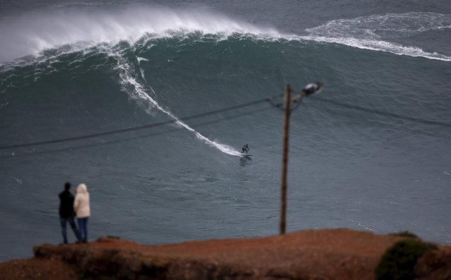 Big wave surfer Sebastian Steudtner of Germany drops in on a large wave at Praia do Norte in Nazare, Portugal November 1, 2015. The Praia do Norte beach has become a famous beach for big wave surfers around the world since Hawaiian surfer Garrett McNamara got a world record for the largest wave surfed in 2011. (Photo by Rafael Marchante/Reuters)
