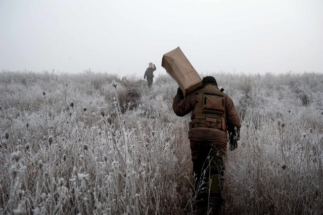 Vuhlegirsk, Ukraine. February 15th, 2015. Members of the first artillery brigade Slavic recover supplies provided by their comrades on their different positions around Debaltseve. After weeks of fighting with artillery and surrounding every day a little more the Ukrainian army, pro-Russian forces have recovered the town of Debaltsevo ,despite the Minsk agreement signed on February 15th, 2015. (Photo by Capucine Granier-Deferre/Getty Images)